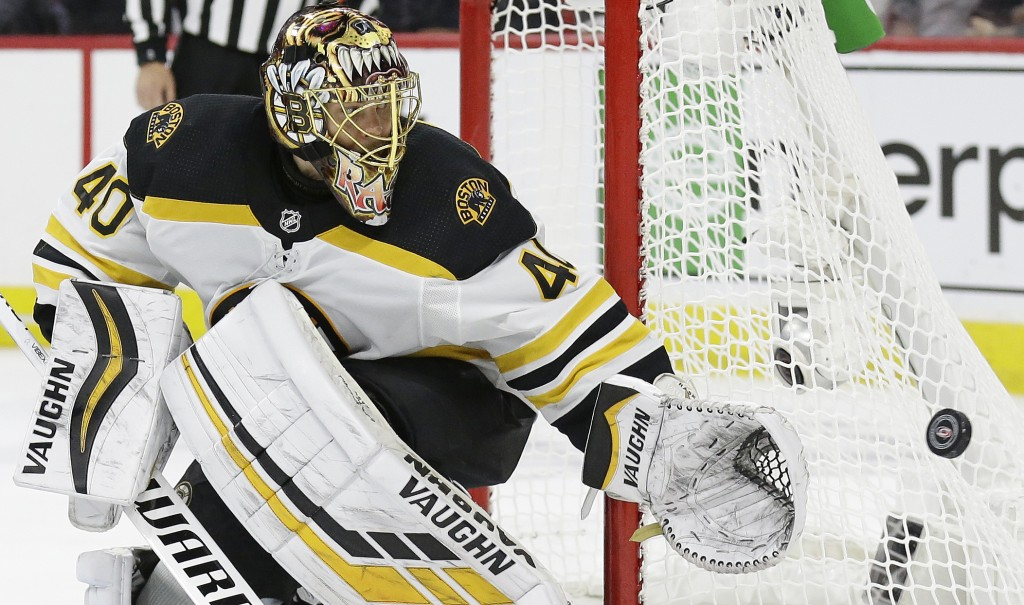 Boston Bruins goalie Tuukka Rask (40), of Finland, defends the goal against the Carolina Hurricanes during the second period in Game 4 of the NHL hock
