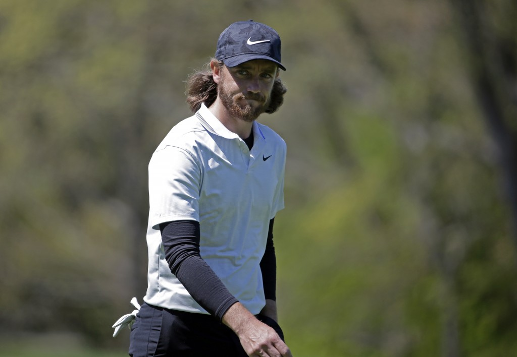 Tommy Fleetwood, of England, walks on the fourth green during the first round of the PGA Championship golf tournament, Thursday, May 16, 2019, at Beth