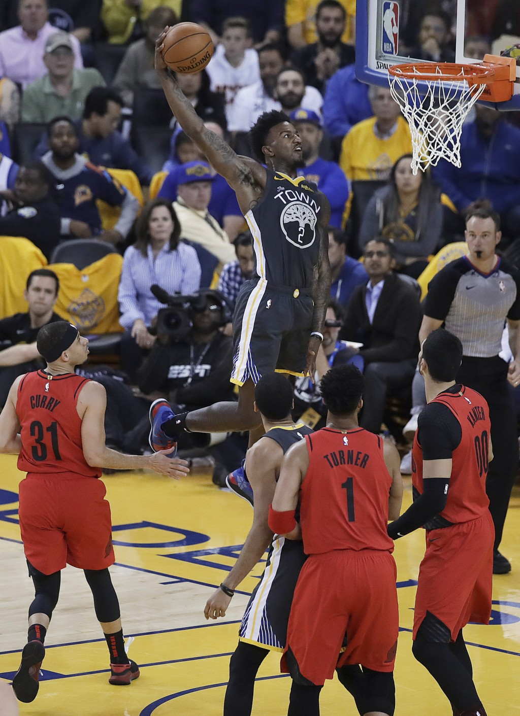 Golden State Warriors forward Jordan Bell (2) dunks against the Portland Trail Blazers during the first half of Game 2 of the NBA basketball playoffs