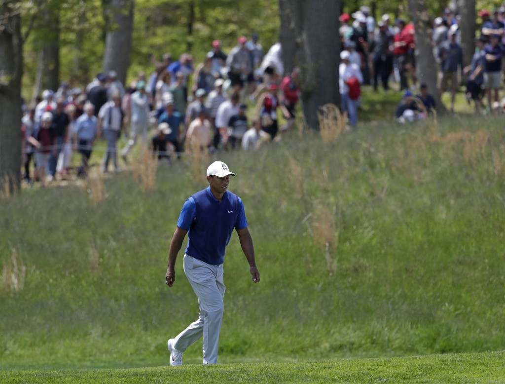 Tiger Woods walks the fifth fairway during the first round of the PGA Championship golf tournament, Thursday, May 16, 2019, at Bethpage Black in Farmi