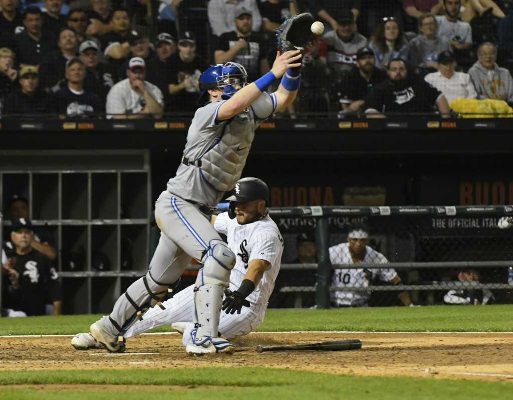 Chicago White Sox's Yolmer Sanchez scores past Toronto Blue Jays catcher Danny Jansen during the eighth inning of a baseball game Thursday, May 16, 20