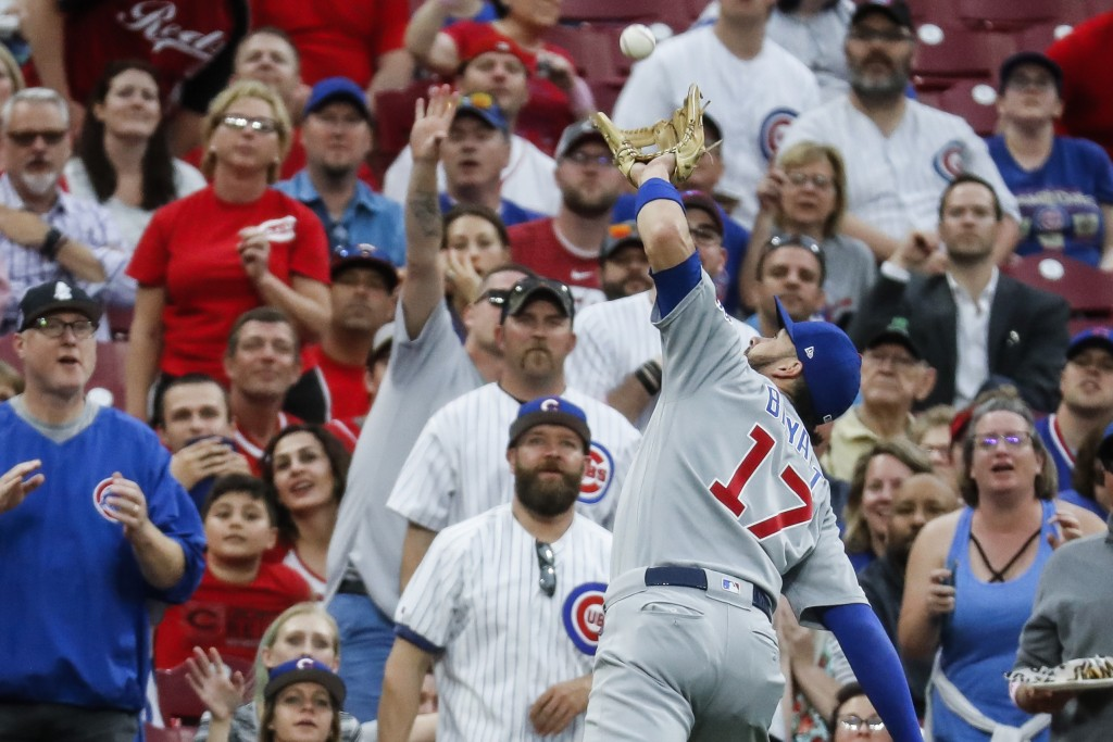 Chicago Cubs' Kris Bryant catches a pop fly by Cincinnati Reds' Joey Votto during the first inning of a baseball game Thursday, May 16, 2019, in Cinci