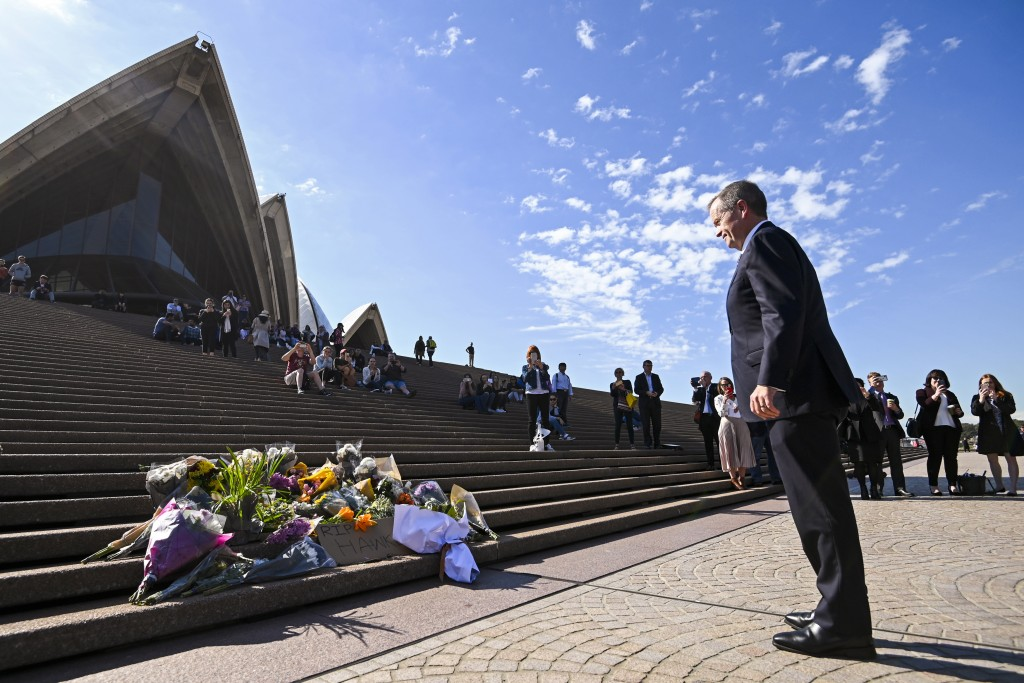 Australian Labor Party leader Bill Shorten, right, pauses after placing a floral tribute to the late former Australian Prime Minster Bob Hawke at the
