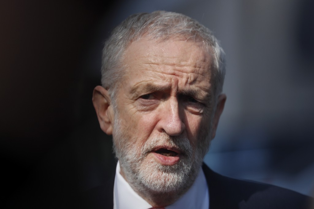 FILE - In this Thursday, March 21, 2019 file photo, British Labour Party leader Jeremy Corbyn speaks outside EU headquarters in Brussels. Cross-party ...