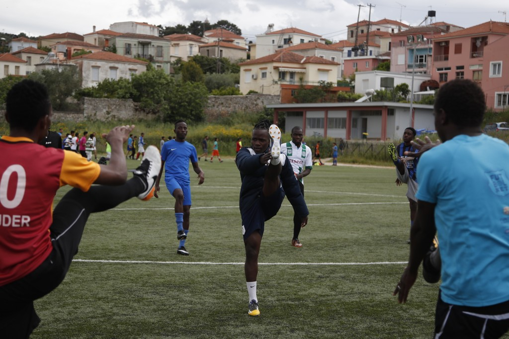 In this Saturday, May 4, 2019, Francis Kalombo from Congo, center, warms up with other players of Cosmos FC ahead of a friendly match between African ...