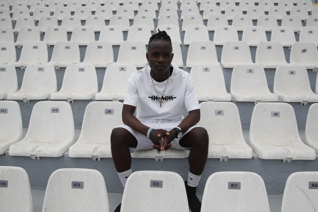 In this Saturday, May 4, 2019, Francis Kalombo from Congo poses for a photograph at the Municipality stadium of Mytilene, on the northeastern Aegean i...