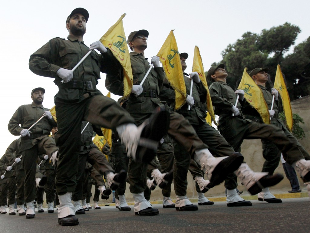 FILE - In this Nov. 12, 2010 file photo, Hezbollah fighters parade during the inauguration of a new cemetery for their fighters who died in fighting a