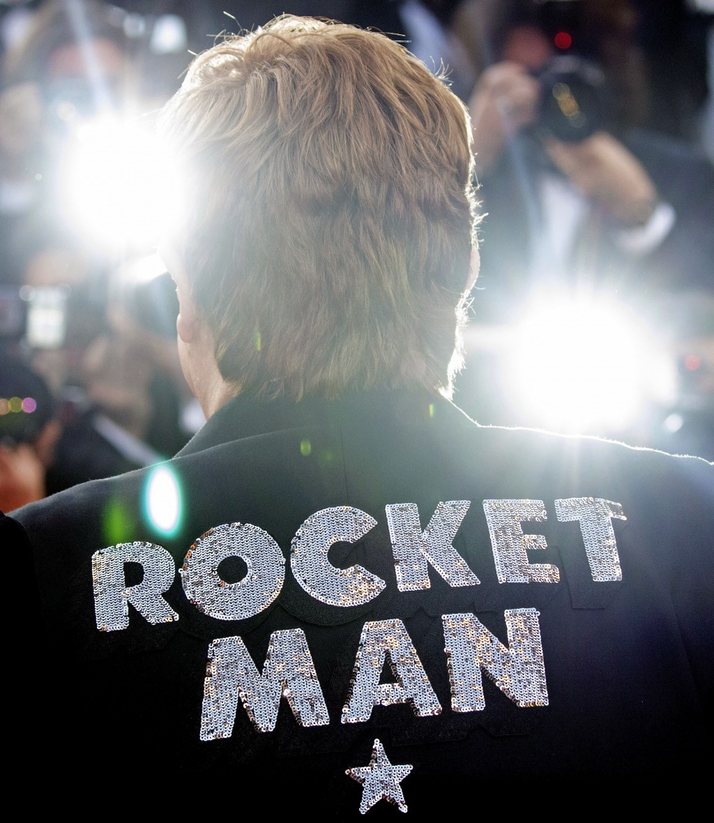 Musician Elton John poses for photographers upon his arrival at the premiere of the film 'Rocketman' at the 72nd international film festival, Cannes,