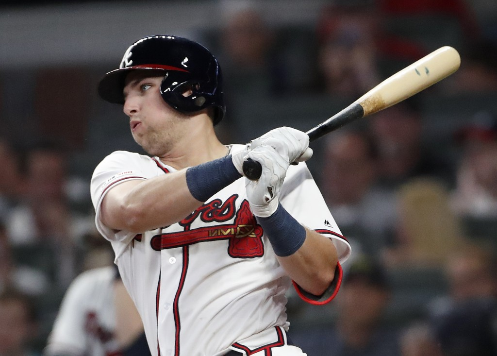 CORRECTS TO FIFTH INNING, INSTEAD OF SIXTH - Atlanta Braves' rookie Austin Riley follows through on a base hit in the fifth inning of the team's baseb
