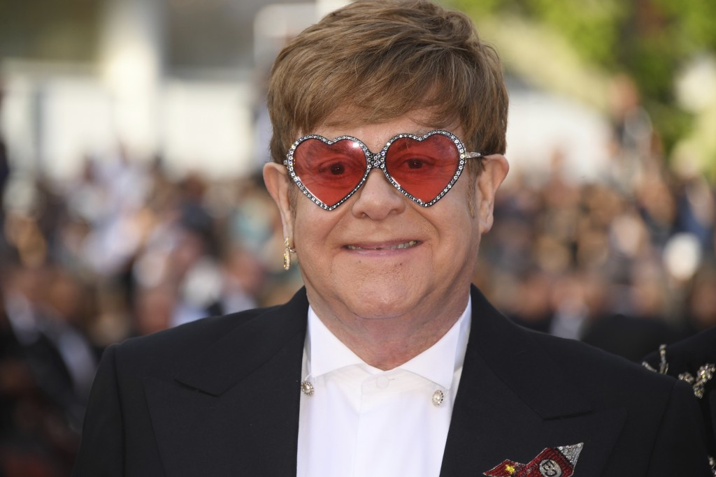 Singer Elton John poses for photographers upon arrival at the premiere of the film 'Rocketman' at the 72nd international film festival, Cannes, southe