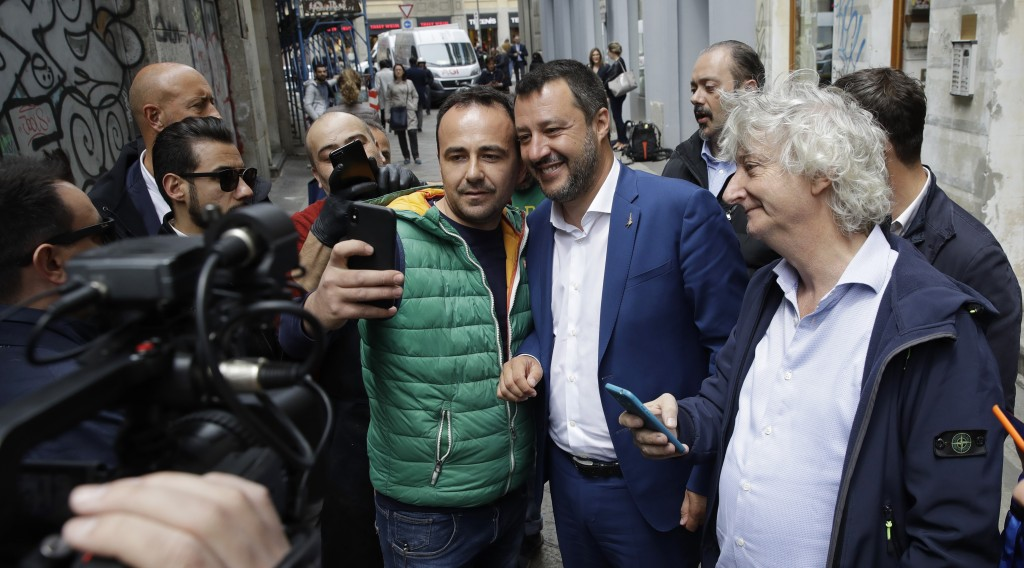 Italian Interior Minister and Deputy-Premier, Matteo Salvini, center-right, takes a selfie as he arrives for a press conference at the foreign press a...