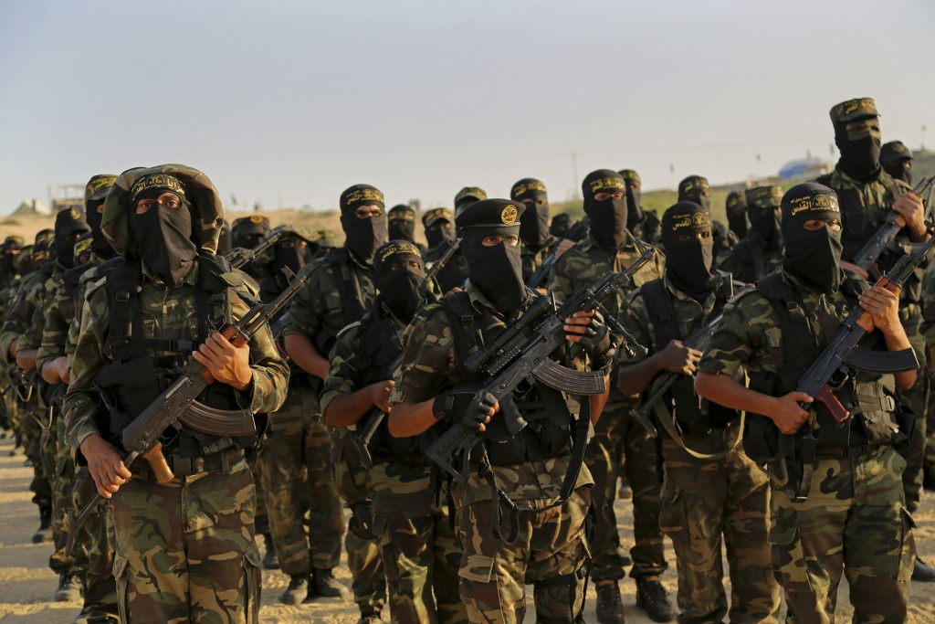 FILE - In this Dec. 11, 2014 file photo, Palestinian militants of the Islamic Jihad group take part in their military exercises in Deir el-Balah, the ...