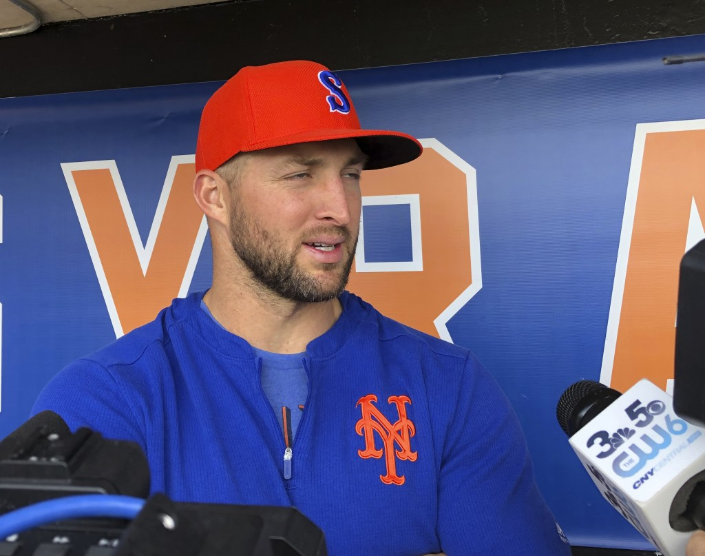 Syracuse Mets' Tim Tebow speaks with reporters prior to a minor league baseball game, Thursday, May 16, 2019 in Syracuse, N.Y. The former Heisman Trop...