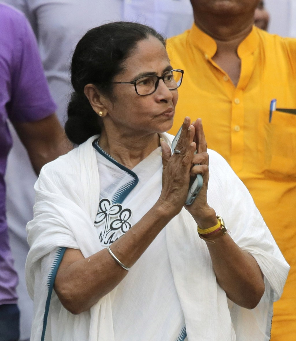 FILE- In this Friday, May 10, 2019 file photo, Trinamool Congress party leader and Chief Minister of West Bengal state Mamata Banerjee greets the crow