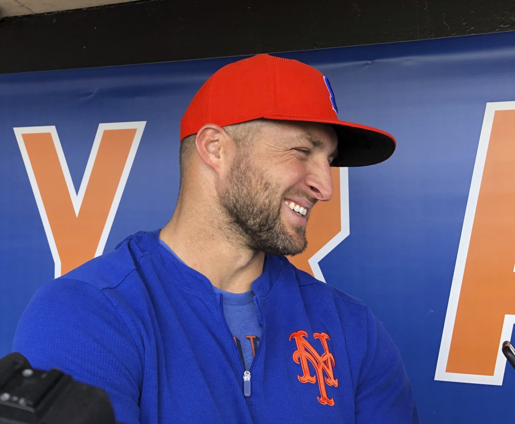 Syracuse Mets' Tim Tebow speaks with reporters prior to a minor league baseball game, Thursday, May 16, 2019 in Syracuse, N.Y. The former Heisman Trop