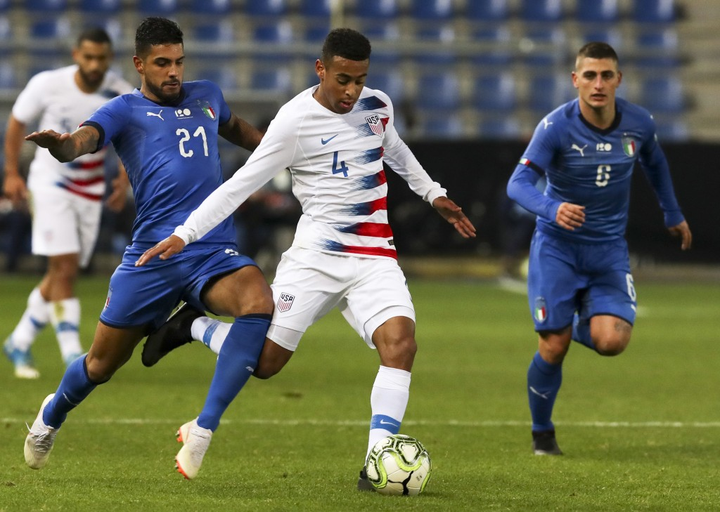FILE - In this Tuesday, Nov. 20, 2018 file photo, Italy's Emerson (21), United States' Tyler Adams (4) and Italy's Marco Verratti (6) fight for the ba