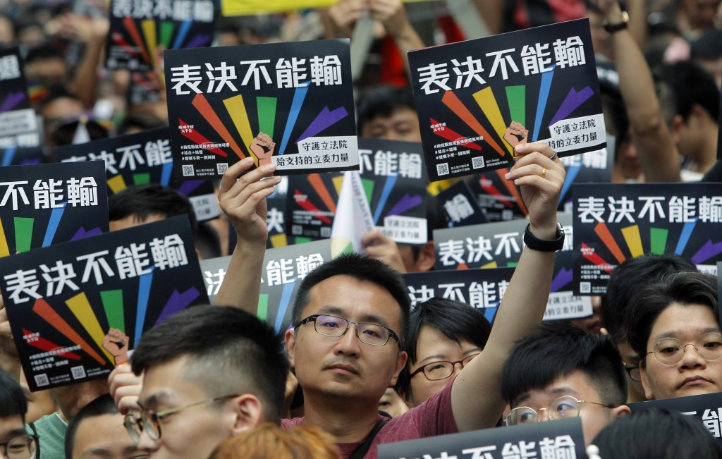 Same-sex marriage supporters gather outside the Legislative Yuan in Taipei, Taiwan, Friday, May 17, 2019. Taiwan's Constitutional Court is scheduled t...