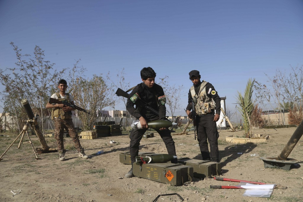 FILE - In this March 15, 2015 file photo, young Shiite volunteer militia members prepare to attack Islamic State fighters in Tikrit, north of Baghdad,