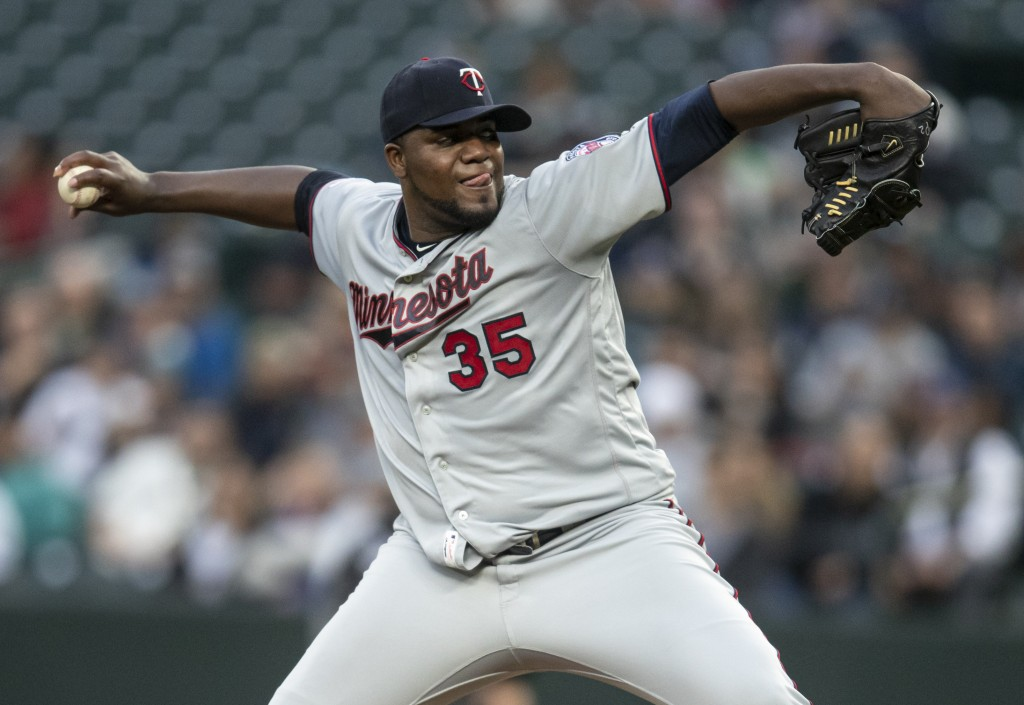 Minnesota Twins starter Michael Pineda delivers a pitch during the second inning of the team's baseball game against the Seattle Mariners, Thursday, M