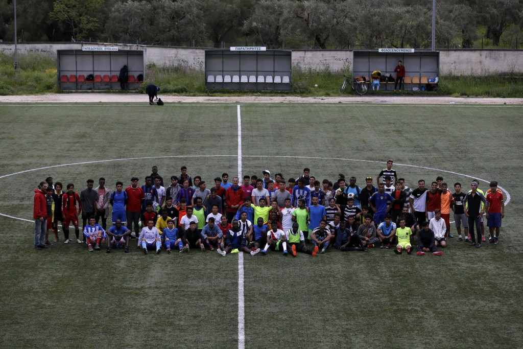 In this Saturday, May 4, 2019, Cosmos FC players pose for a photograph at a soccer field in Moria village, on the northeastern Aegean island of Lesbos