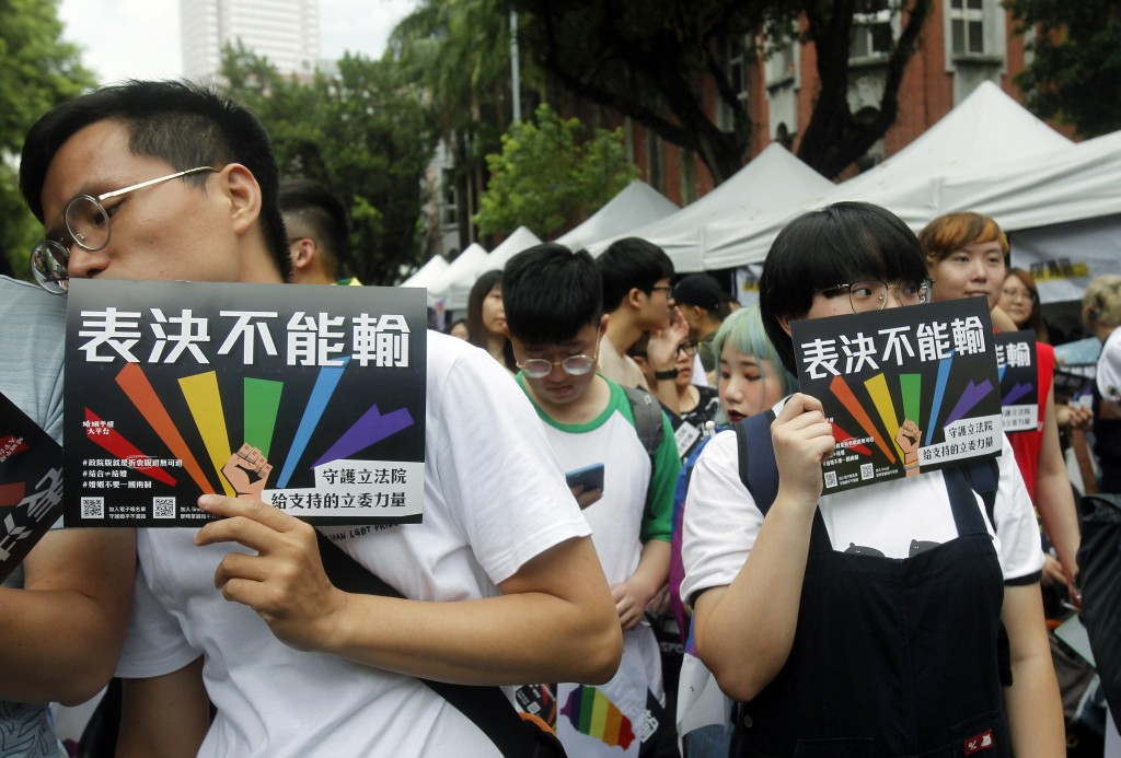 Same-sex marriage supporters gather outside the Legislative Yuan in Taipei, Taiwan, Friday, May 17, 2019. Taiwan's Constitutional Court is scheduled t
