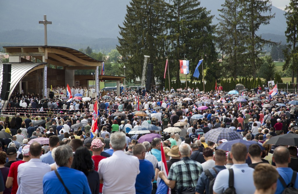 FILE - In this Saturday, May 12, 2018 file photo, mourners from Croatia gather at the memorial site in Bleiburg, Austria. Thousands will gather in a f