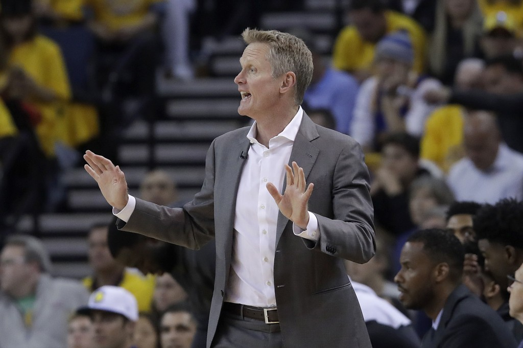 Golden State Warriors coach Steve Kerr gestures during the first half of Game 2 of the team's NBA basketball playoffs Western Conference finals agains