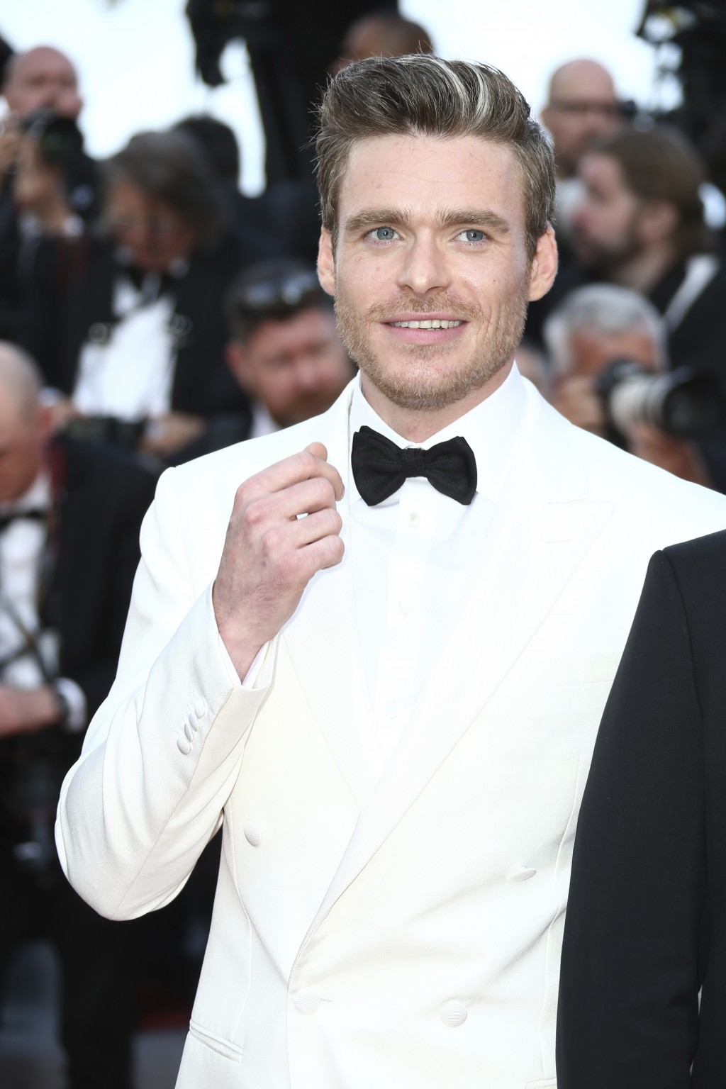 Actor Richard Madden poses for photographers upon arrival at the premiere of the film 'Rocketman' at the 72nd international film festival, Cannes, sou