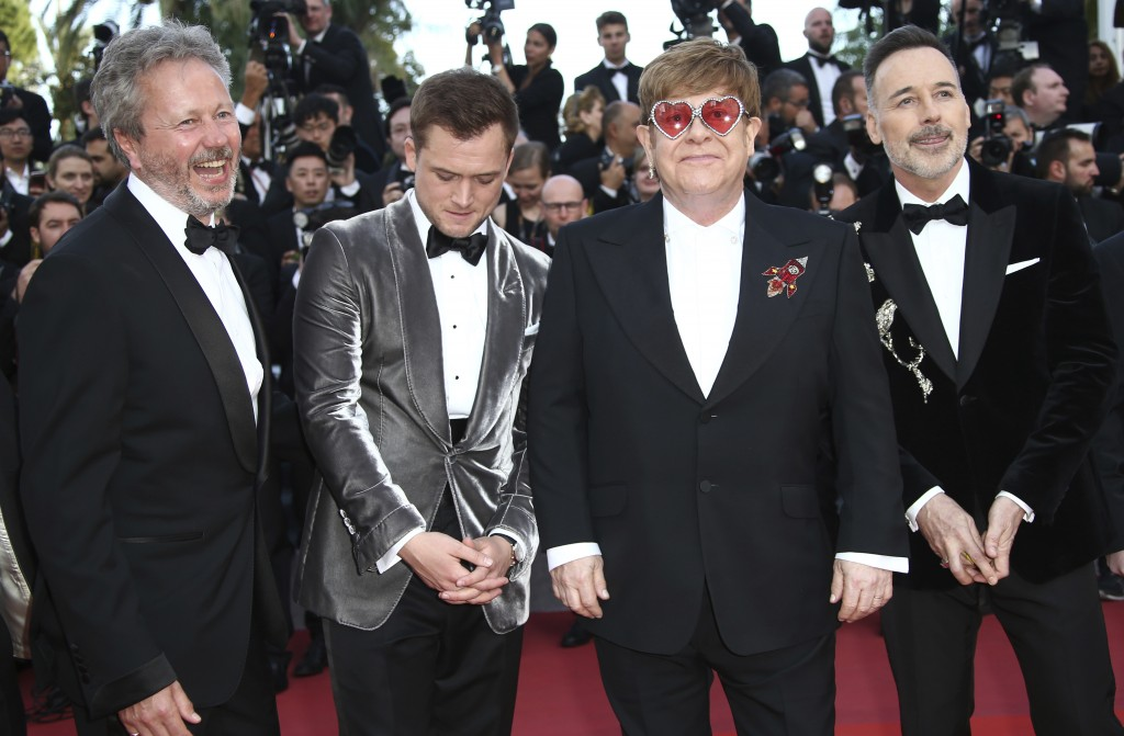 Producer Adam Bohling, actor Taron Egerton, singer Elton John and producer David Furnish pose for photographers upon arrival at the premiere of the fi