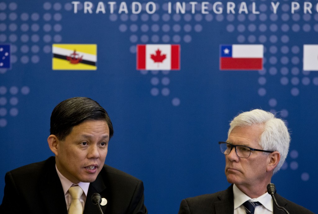 Singapore's Industry and Trade Minister Chan Chun Sing, speaks next to James Carr, Minister of International Trade Diversification of Canada during a ...