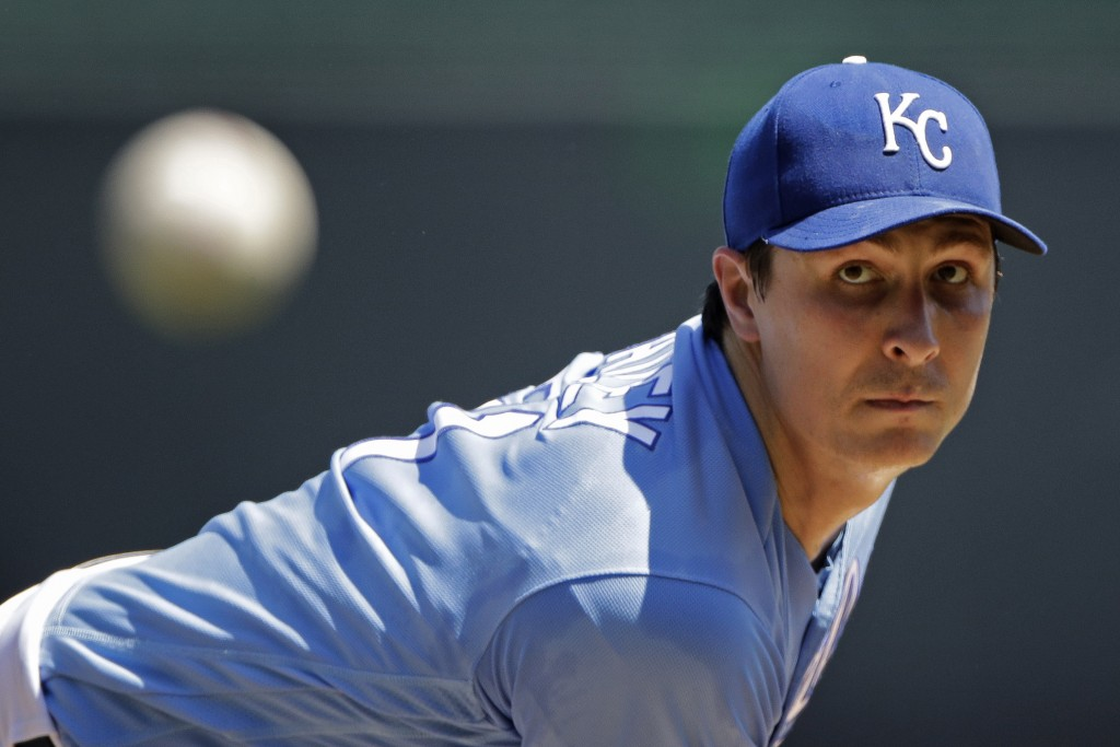 Kansas City Royals starting pitcher Homer Bailey throws during the first inning of a baseball game against the Texas Rangers, Thursday, May 16, 2019,