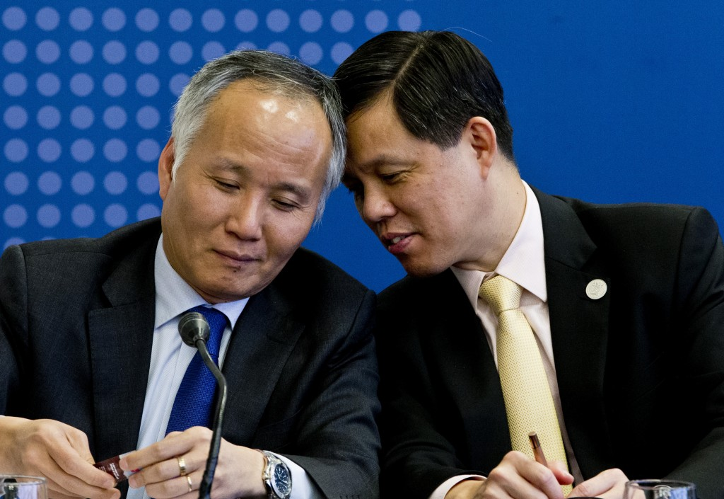 Tran Quoc Khanh, Vietnam's Deputy Minister of Industry and Trade, left, talks with Singapore's Industry and Trade Minister Chan Chun Sing, during a me...