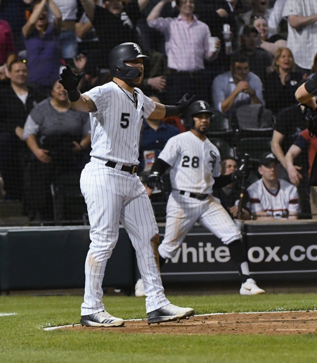 Chicago White Sox's Yolmer Sanchez (5) yells after he scored against the Toronto Blue Jays during the eighth inning of a baseball game Thursday, May 1...