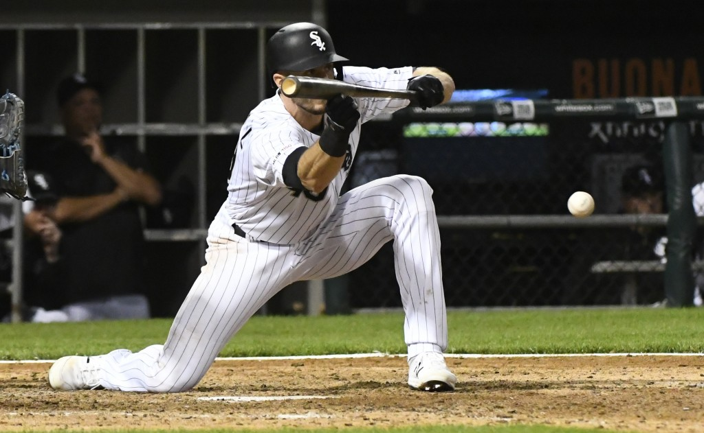 CORRECTS TO EIGHTH INNING, INSTEAD OF NINTH - Chicago White Sox's Ryan Cordell hits a sacrifice bunt during the eighth inning of the team's baseball g...