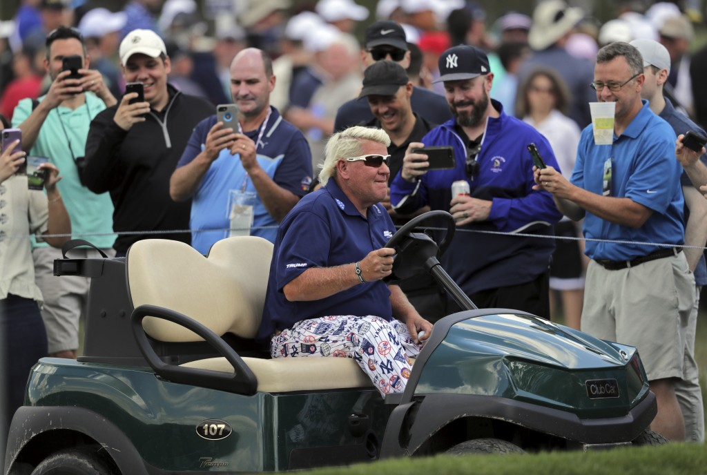 John Daly drives to the 10th tee in a golf cart during the first round of the PGA Championship golf tournament, Thursday, May 16, 2019, at Bethpage Bl...