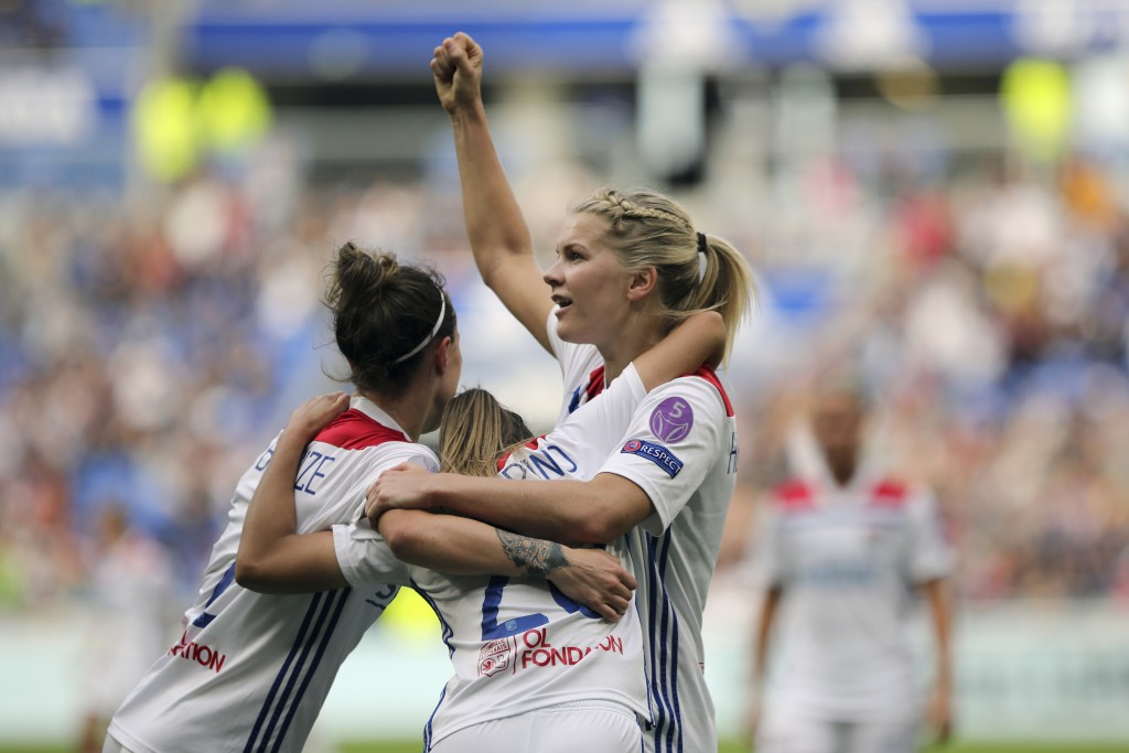 FILE - In this Sunday, April 21, 2019 file photo, Lyon's Delphine Cascarino, center, celebrates with Ada Hegerberg, right, and Lucy Bronze after scori