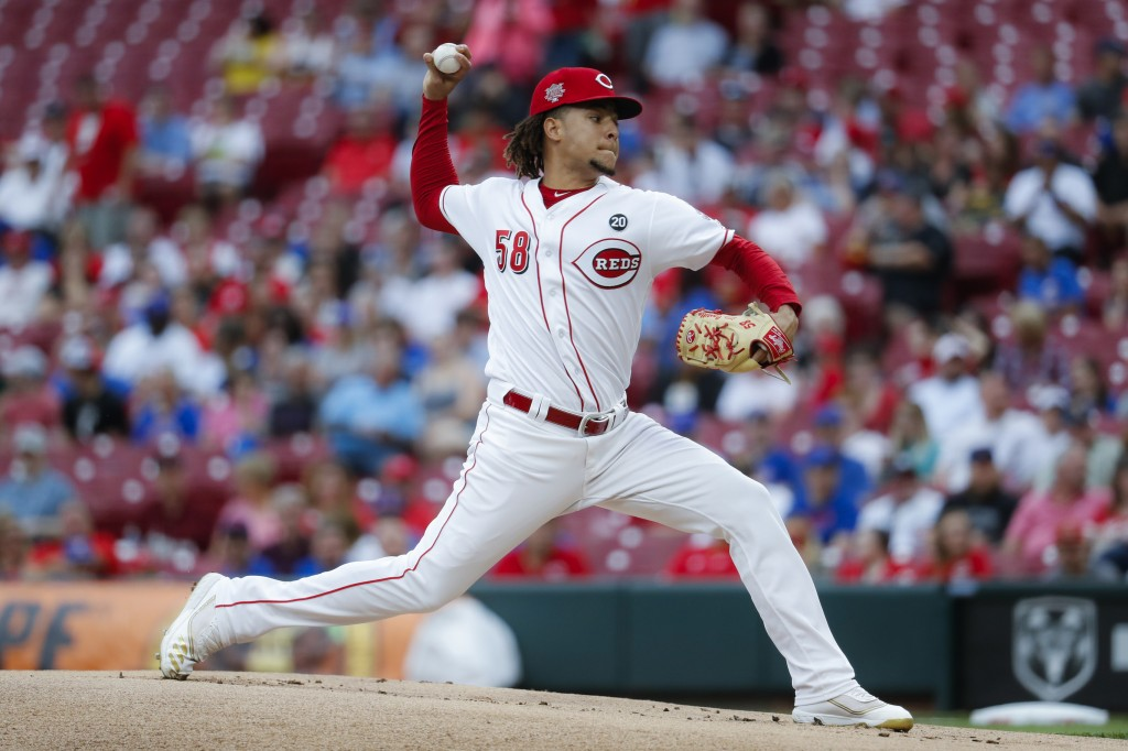 Cincinnati Reds starting pitcher Luis Castillo throws during the first inning of the team's baseball game against the Chicago Cubs, Thursday, May 16,