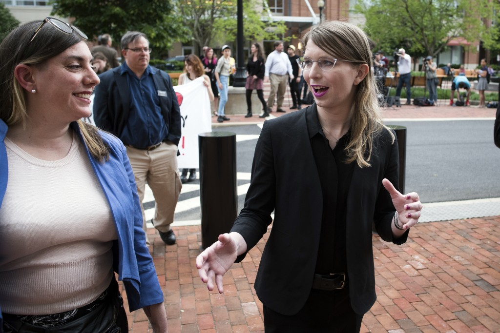 Former Army intelligence analyst Chelsea Manning speaks with her attorney Moira Meltzer-Cohen, as they walk to the federal court, in Alexandria, Va.,