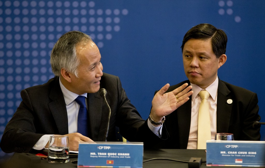 Tran Quoc Khanh, Vietnam's Deputy Minister of Industry and Trade, left, speaks next to Singapore's Industry and Trade Minister Chan Chun Sing, during ...