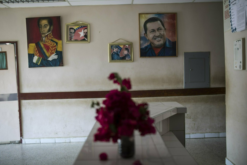 Portraits of Venezuela's late President Hugo Chavez, right, Cuban leader Fidel Castro, center, Jose Martin, second from left, and Venezuela's Independ...