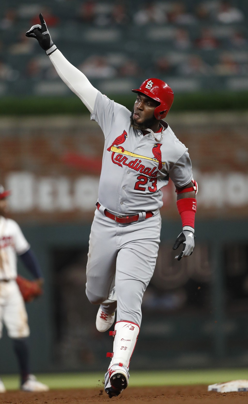 St. Louis Cardinals' Marcell Ozuna gestures as he rounds the bases after hitting a solo home run in the sixth inning of the team's baseball game again