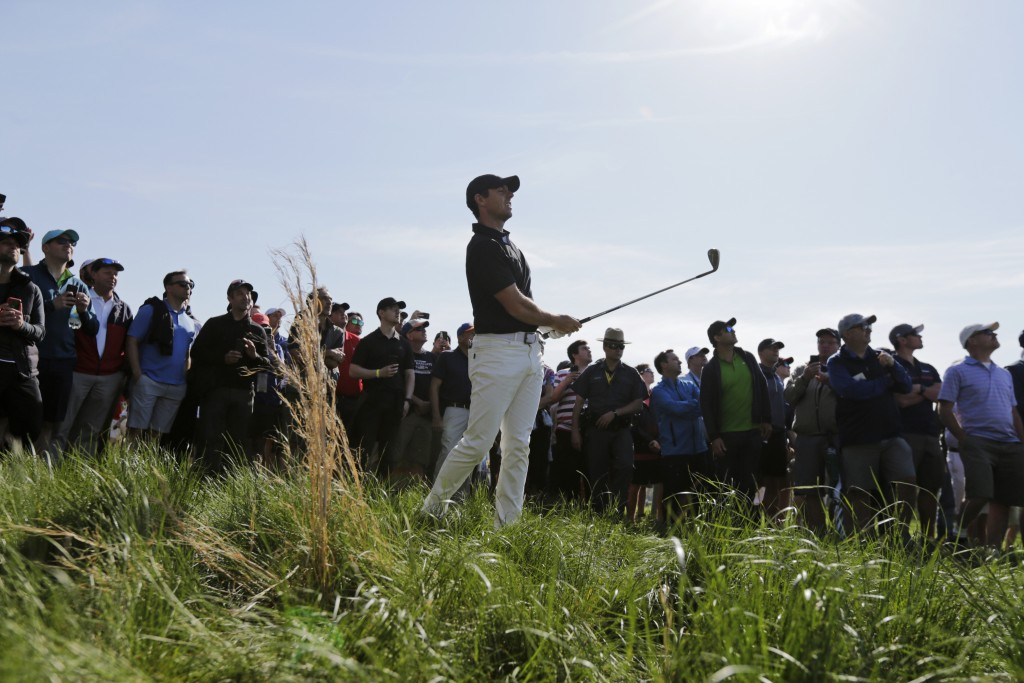 Rory McIlroy, of Northern Ireland, reacts to his hit out of the rough on the 12th hole during the second round of the PGA Championship golf tournament...