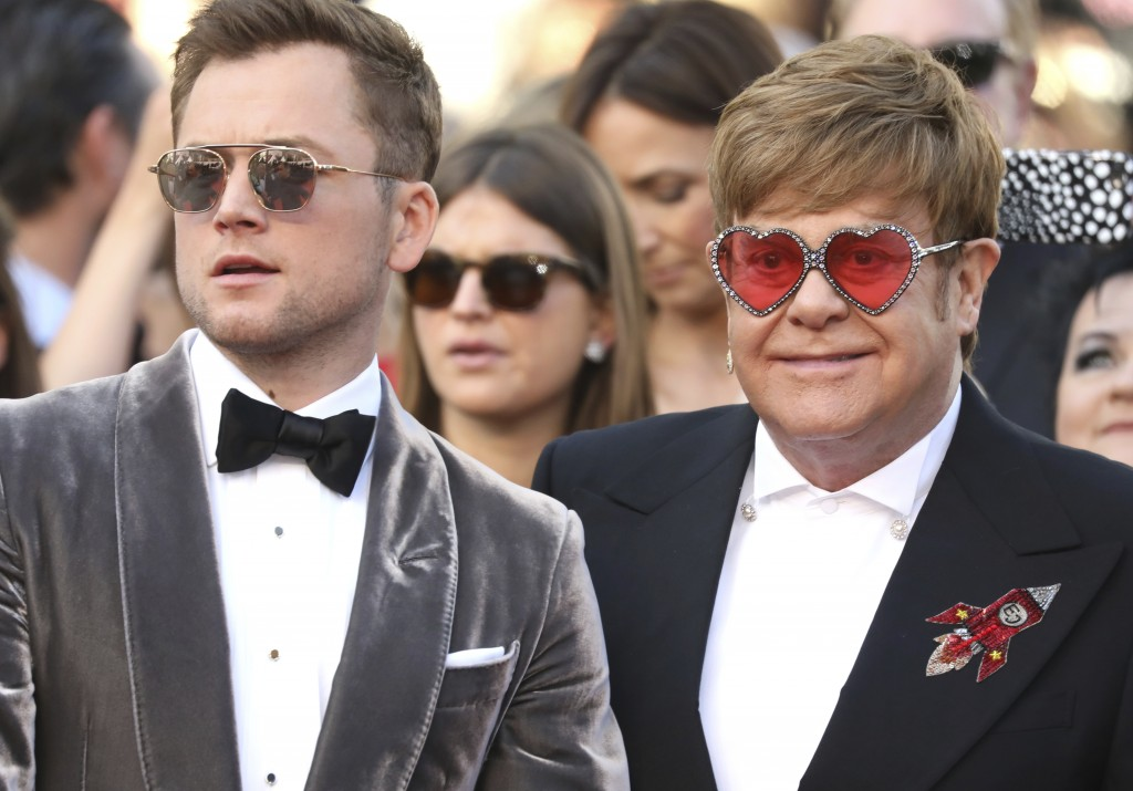 Actor Taron Egerton, left, and singer Elton John pose for photographers upon arrival at the premiere of the film 'Rocketman' at the 72nd international