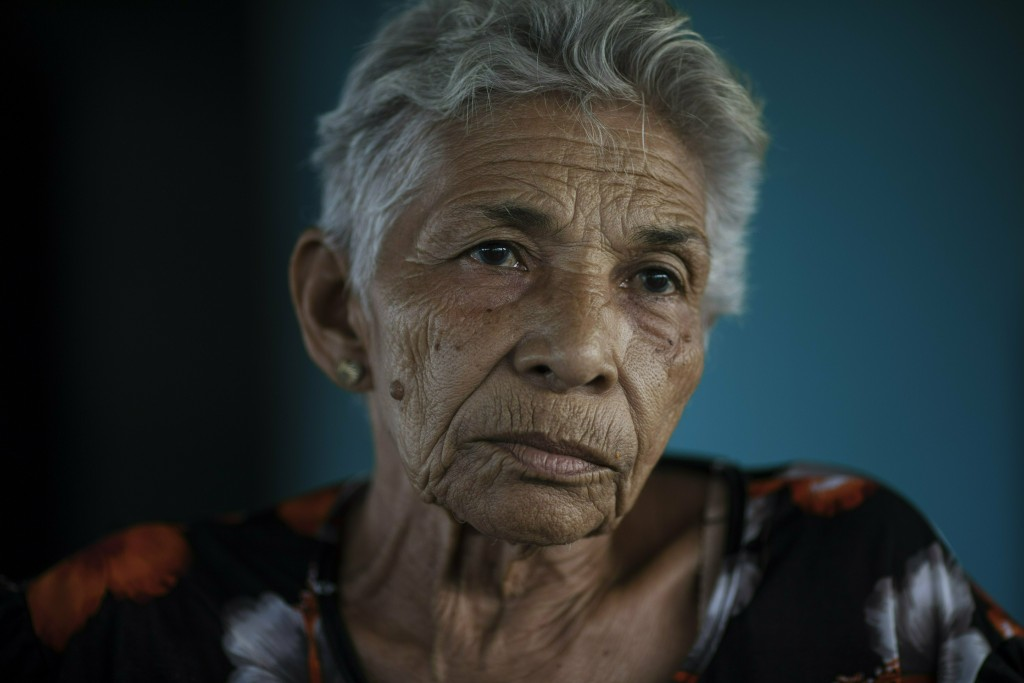 Ana Morffe, who witnessed the 1967 Cuban invasion, pauses during an interview in Machurucuto, Venezuela, Sunday, May 5, 2019. Morffe said she didn't e