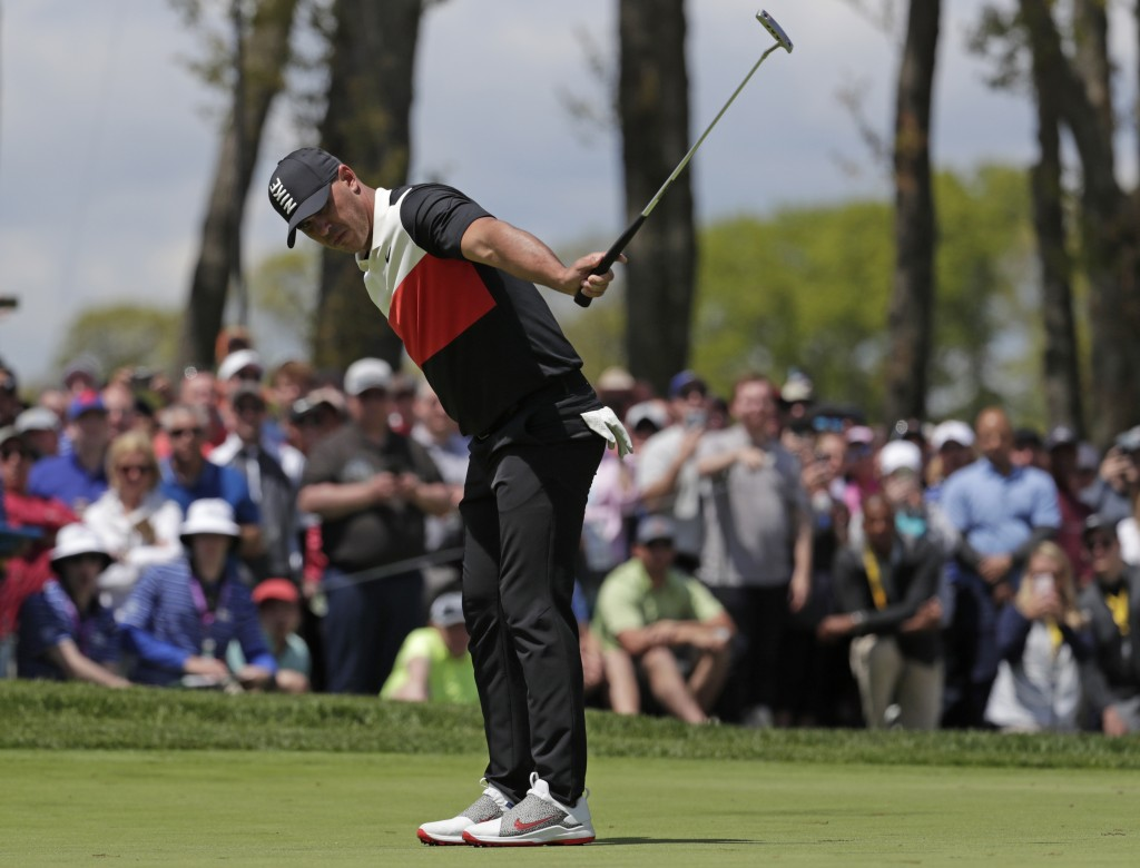 Brooks Koepka watches his putt drop for birdie on the ninth hole during the first round of the PGA Championship golf tournament, Thursday, May 16, 201