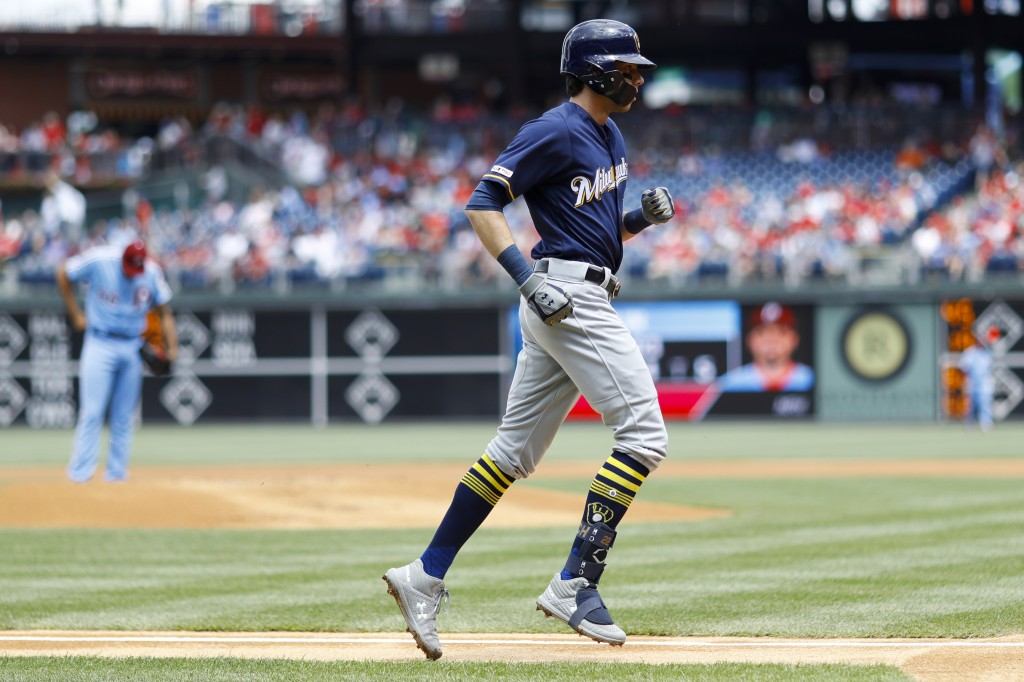 Milwaukee Brewers' Christian Yelich, right, rounds the bases after hitting a home run off Philadelphia Phillies starting pitcher Zach Eflin, left, dur