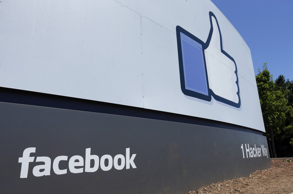 FILE - This July 16, 2013 file photo shows a sign at Facebook headquarters in Menlo Park, Calif. Facebook said Thursday, May 16, 2019, that it has ban...