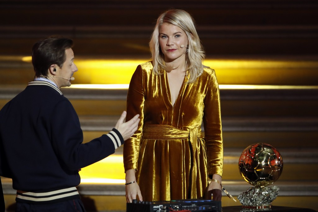 FILE - In this Monday Dec. 3, 2018 file photo, French DJ and musician Martin Solveig, left, talks to Olympique Lyonnais' Ada Hegerberg, of Norway, dur
