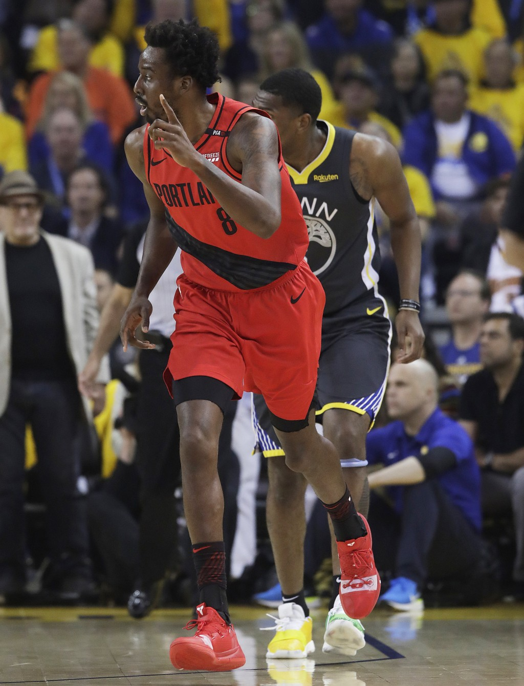 Portland Trail Blazers forward Al-Farouq Aminu (8) gestures after scoring against the Golden State Warriors during the first half of Game 2 of the NBA