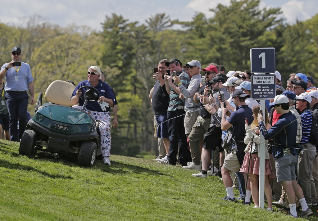 John Daly drives up to the first tee in a golf cart during the first round of the PGA Championship golf tournament, Thursday, May 16, 2019, at Bethpag...